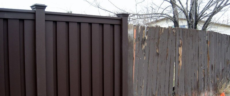 A Trex Fence next to a rotting wood fence