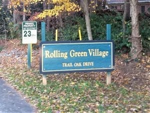 the entrance sign for Rolling Green Village HOA