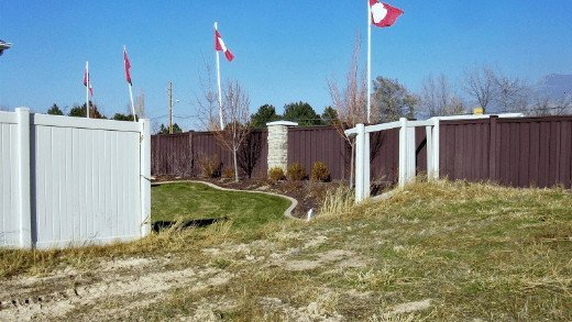 A Trex fence in the background is still standing while a PVC vinyl fence in front has been blown out due to high winds.