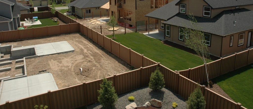 Trex Fencing dividing yards in a home owner association located in a dry, hot climate