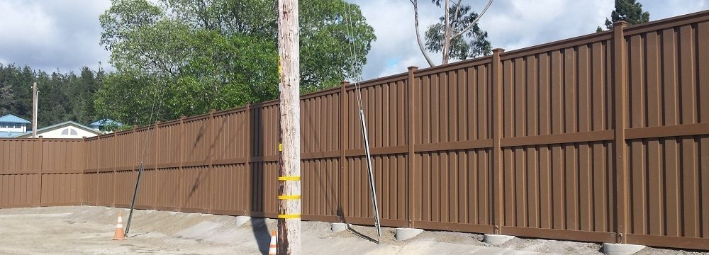 An electrical substation enclosure in Mendocino CA using Trex Fencing.