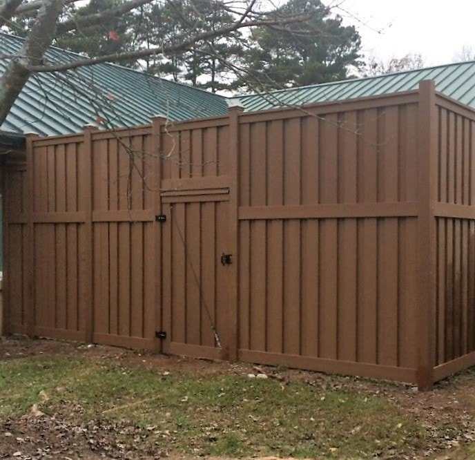 A space secured by 10 ft. tall Trex Fencing and a gate.