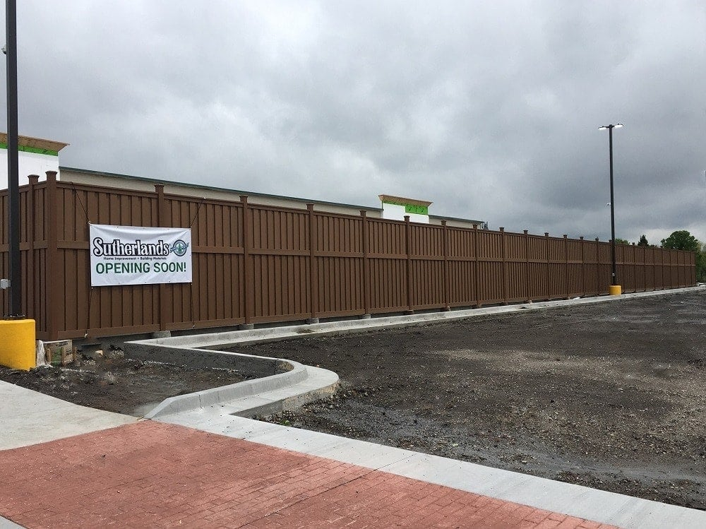 A tall perimeter built from Trex Fencing