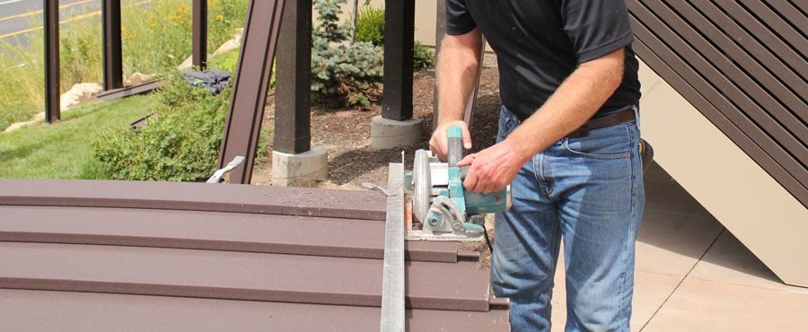 Cutting pickets with a jig to create a sloping Trex Horizons fence