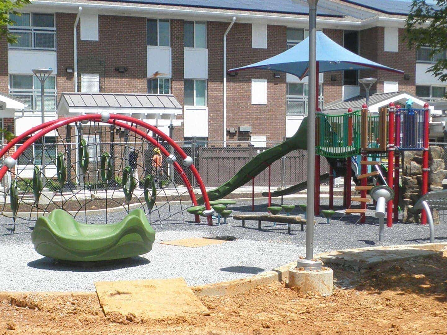 A playground in front of a Trex Seclusions Fence at the Parkway Overlook Apartments complex in Washington DC