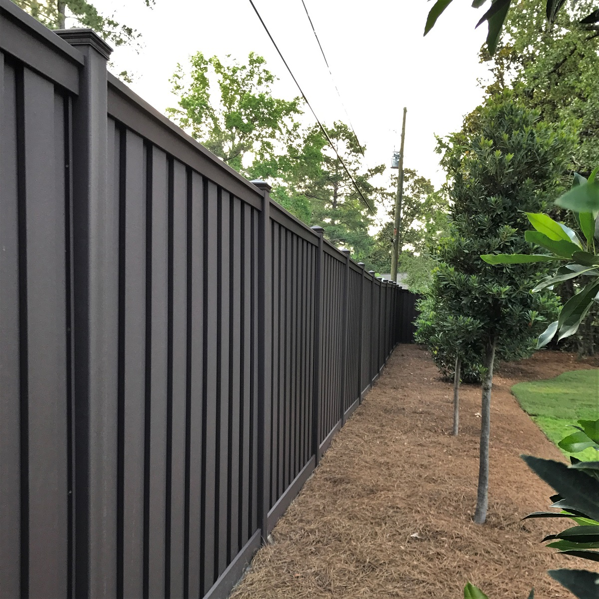 An 8 ft. tall Trex privacy Fence in a South Carolina residence's backyard.