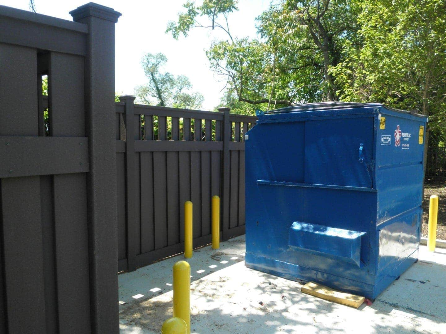 A dumpster enclosure in Washington DC made from the Trex Seclusions composite fencing system