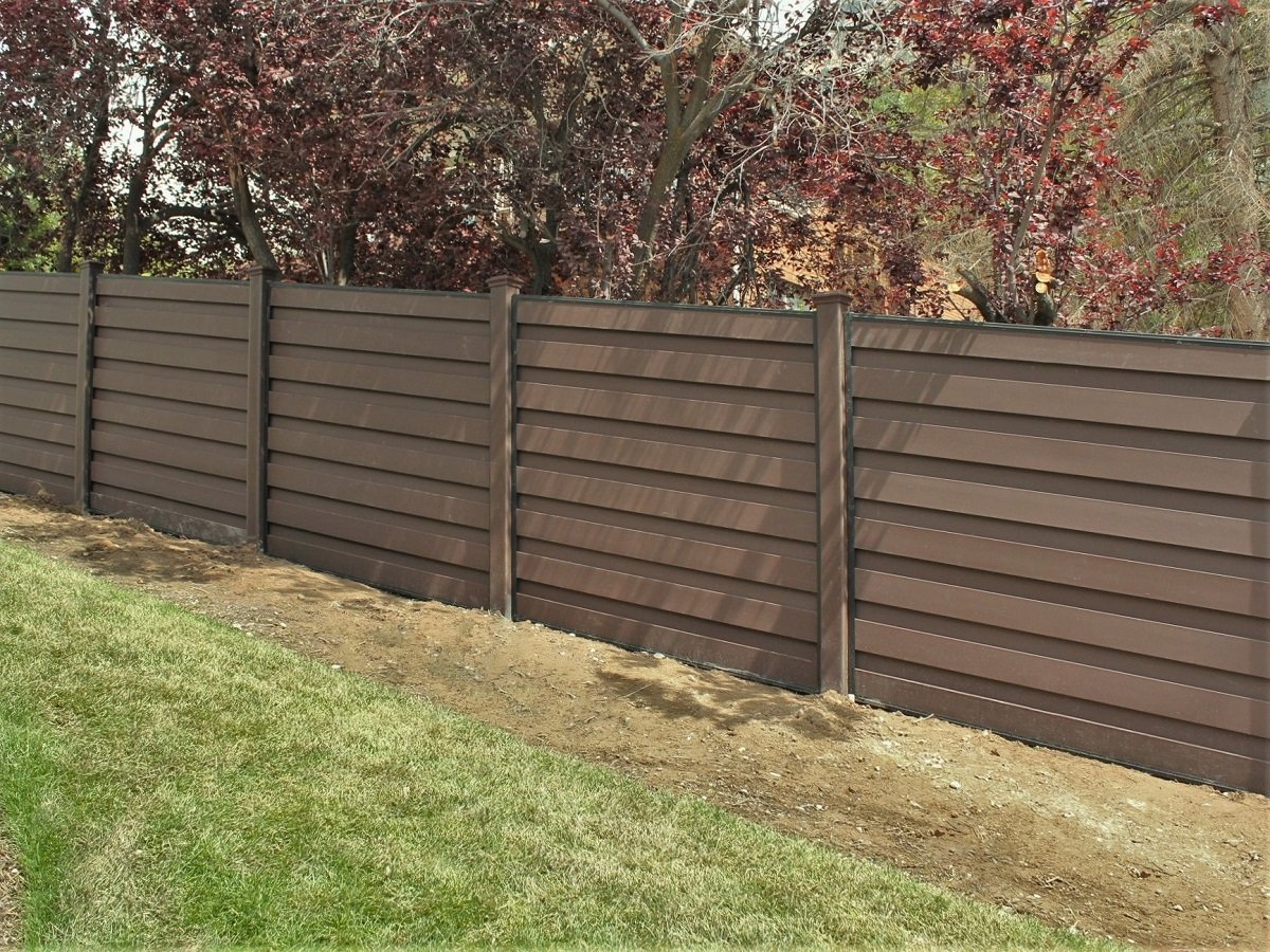 A sloped Trex horizontal fence on a hill