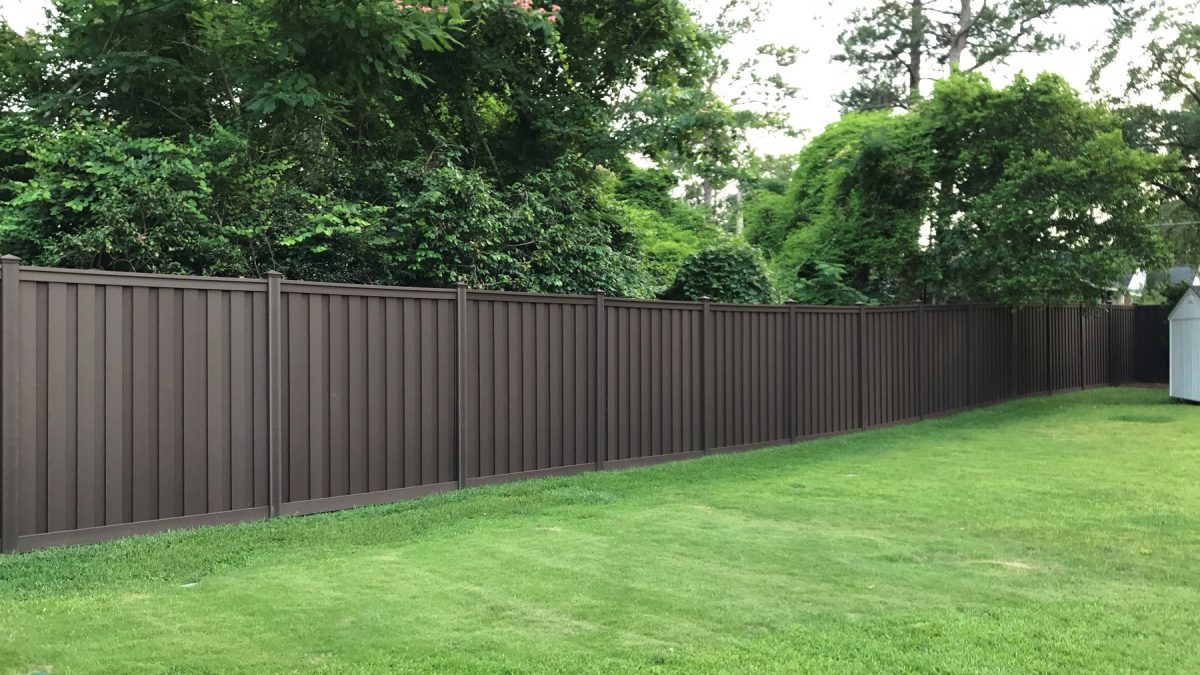 A Trex Seclusions Woodland Brown Privacy Fence in a South Carolina residence's backyard.