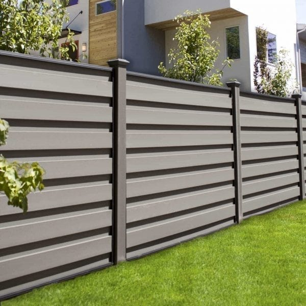 A grey horizontal fence with Trex composite components and FDS Horizons steel frames.