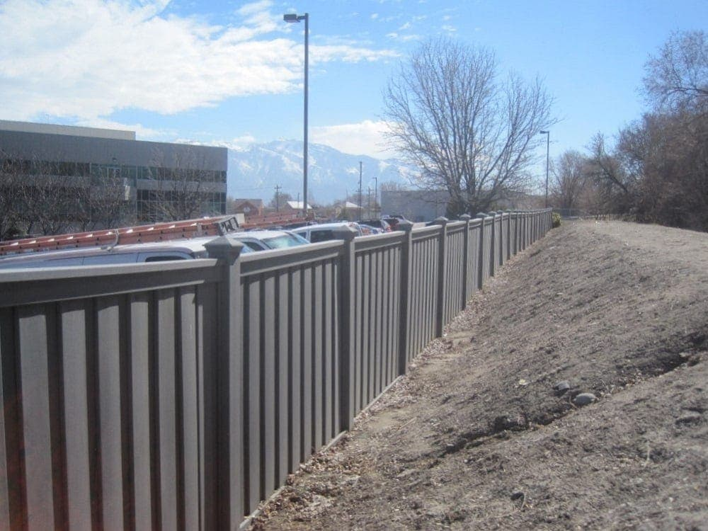 A Trex fence next to a berm and path