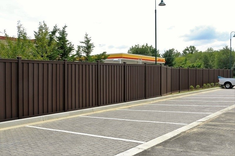 An 8 foot tall Trex Fence next to the Goddard School parking lot in Ellicott City, Maryland.