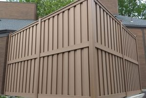 A 10 foot tall Trex privacy fence for a university housing HVAC enclosure