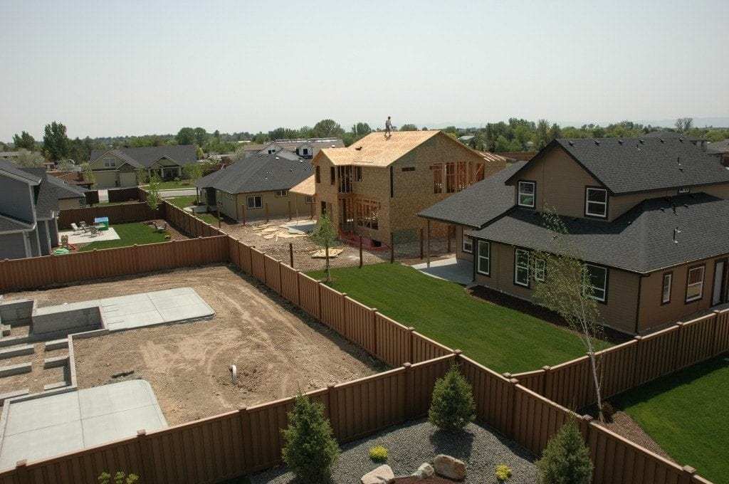 A picture from a high vantage point of a neighborhood with several backyards fenced in with Trex Seclusions.