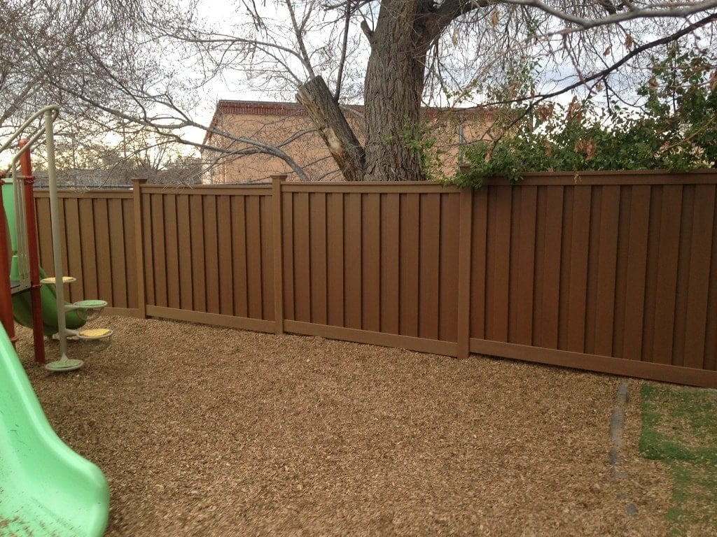 Several sections of Trex Fence protecting a children's play area in Santa Fe, NM.