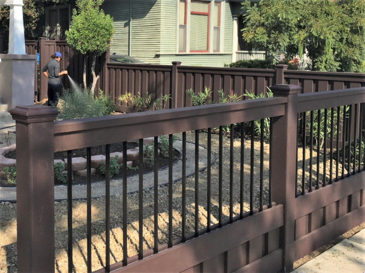 A front yard with a Trex fence using aluminum panels to create a semi-private fence.
