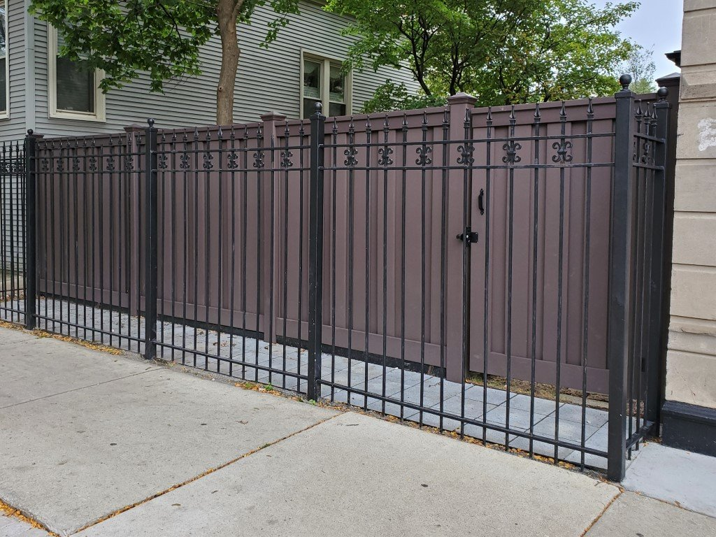 A Trex privacy fence behind an ornamental metal fence