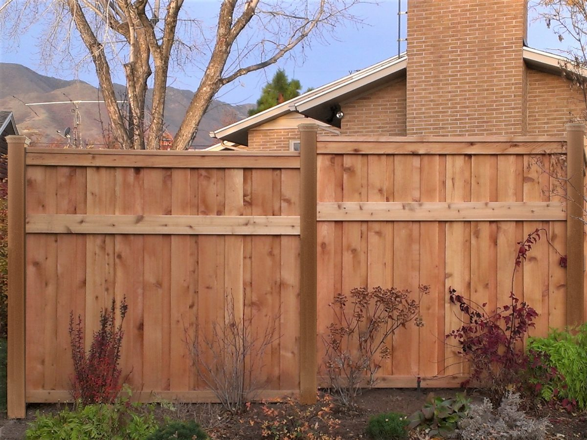 A Wood Fence using Trex composite posts.