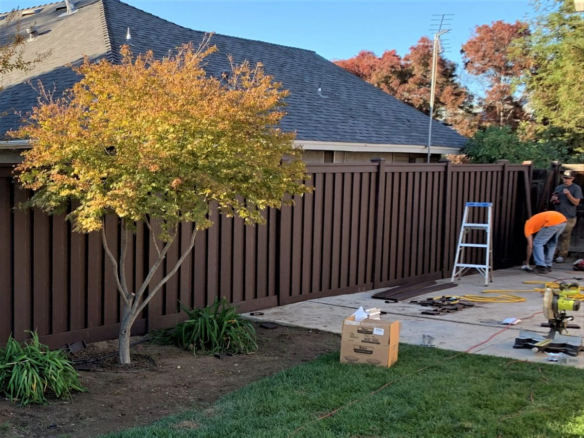 A picture of Coons' Fences fence installation crews building a Trex Fence