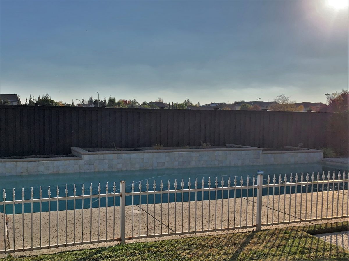 Coons' Fences installation of a Trex fence around a pool.